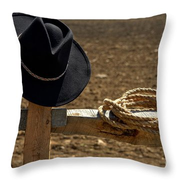 Cowboy Hat And Rope On Fence Throw Pillow by Olivier Le Queinec