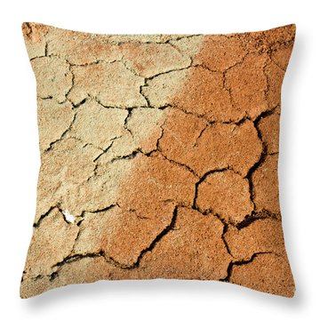 Throw Pillow featuring the photograph Cracked Soil In Red Shades by Les Palenik