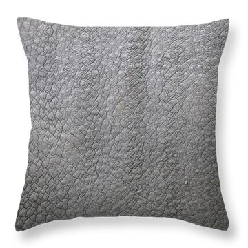 detail of the skin of an Indian rhinoceros in a zoo Netherlands Throw Pillow by Ronald Jansen