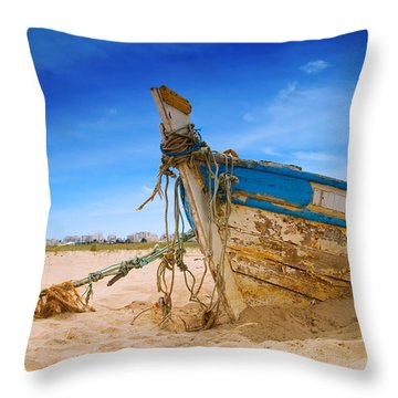 Dilapidated Boat At Ferragudo Beach Algarve Portugal Throw Pillow by Amanda Elwell