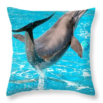 Dolphin Plays Throw Pillow by Michal Bednarek