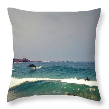 Dolphins Swimming With The Surfers At Asilomar State Beach  Throw Pillow by Joyce Dickens