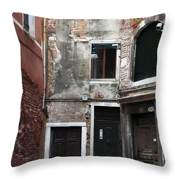 Doors Of All Sizes Throw Pillow by John Rizzuto