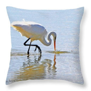 Egret Catches A Fish Throw Pillow by Tom Janca