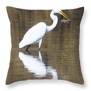 Egret Eats Fish Throw Pillow by Tom Janca