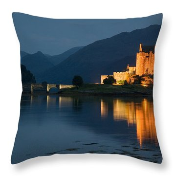 Eilean Donan Castle At Night Throw Pillow by Jeremy Voisey