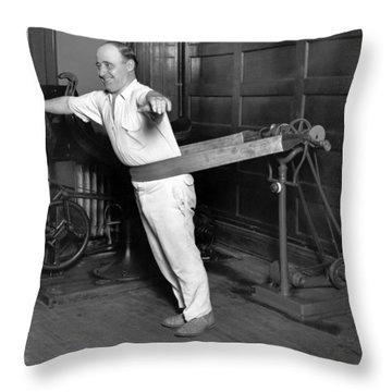 Electrical Vibrating Machine Throw Pillow by Underwood Archives