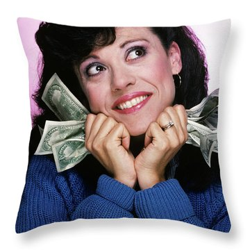 Excited Brunette Woman Holding Several Throw Pillow
