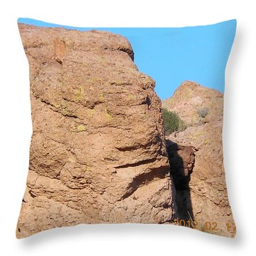 Face Of The Monolith Throw Pillow