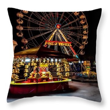 Fairground At Night Throw Pillow by Adrian Evans