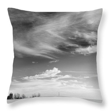 Farm In The Distance In A Snowy Field Throw Pillow by Patrick LaRoque