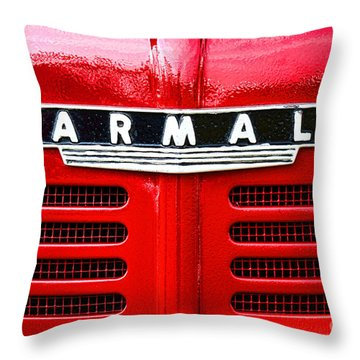 Throw Pillow featuring the photograph Farmall by Olivier Le Queinec