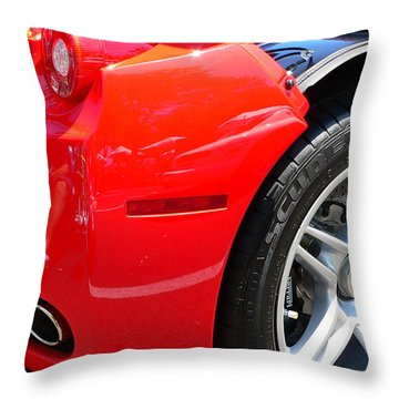 Throw Pillow featuring the photograph Ferrari Rear Panel And Tire by Jeff Lowe