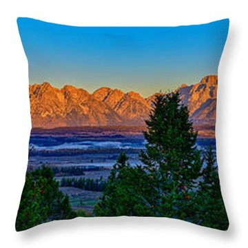 First Light On The Tetons Throw Pillow by Greg Norrell