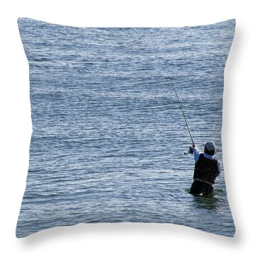 Throw Pillow featuring the photograph First Striper Of The Season by Greg Graham