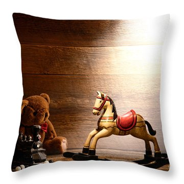 Forgotten Toys Throw Pillow by Olivier Le Queinec
