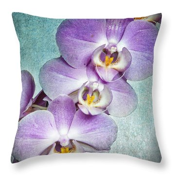 Four Little Orchids Throw Pillow