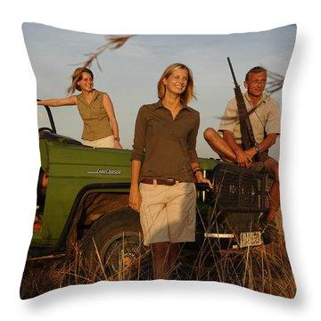 Four People Smiling On Safari Throw Pillow