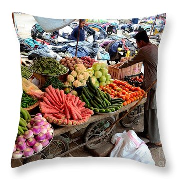 Fruit And Vegetable Seller Tends To His Cart Outside Empress Market Karachi Pakistan Throw Pillow