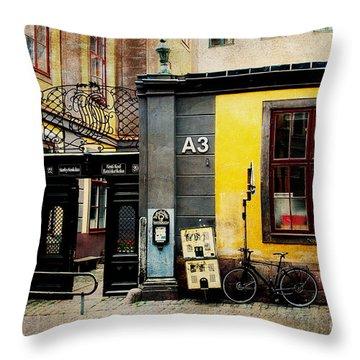 Gamla Stan Street Throw Pillow by Joan McCool