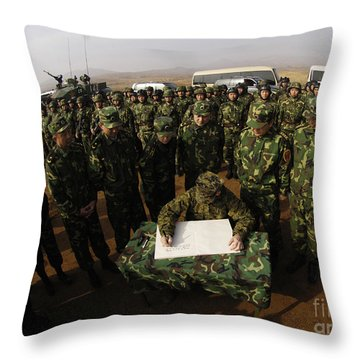General Peter Pace Signs A Message Throw Pillow by Stocktrek Images