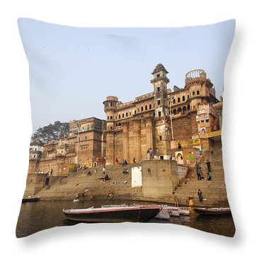 Ghats And Boats On The River Ganges At Varanasi In India Throw Pillow by Robert Preston