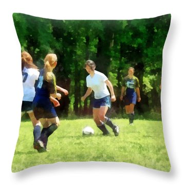 Girls Playing Soccer Throw Pillow