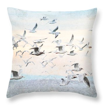 Gulls Flying Over The Ocean Throw Pillow by Peggy Collins