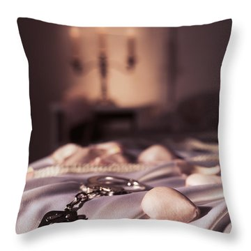 Handcuffs Ropes And Rose Petals On Bed Bdsm Sex Romantic Concept Throw Pillow by Oleksiy Maksymenko