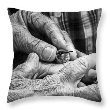 Hands Holding A Hummingbird Throw Pillow