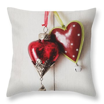 Throw Pillow featuring the photograph Hanging Ornaments On White Background by Sandra Cunningham