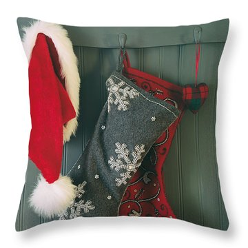 Throw Pillow featuring the photograph Hanging Stockings And Santa Hat On Hook by Sandra Cunningham