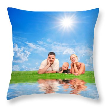 Happy Family Together On Grass Throw Pillow by Michal Bednarek