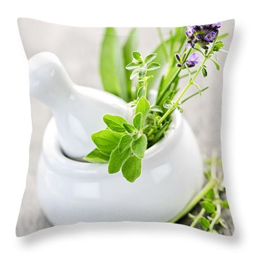 Healing Herbs In Mortar And Pestle Throw Pillow by Elena Elisseeva