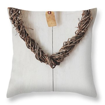 Throw Pillow featuring the photograph Heart Wreath Hanging On Wood Background by Sandra Cunningham