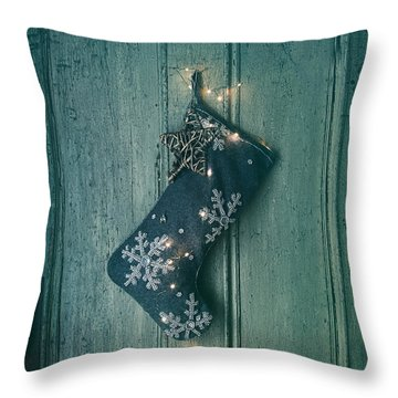 Holiday Stocking With Lights Hanging On Old Door Throw Pillow