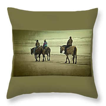 Throw Pillow featuring the photograph Horseback Riding On The Beach by Thom Zehrfeld