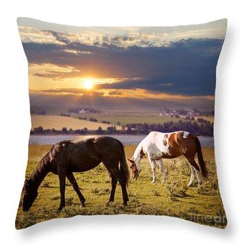 Horses Grazing At Sunset Throw Pillow