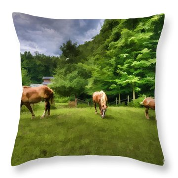 Horses Grazing In Field Throw Pillow by Dan Friend