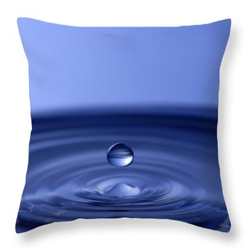 Hovering Blue Water Drop Throw Pillow