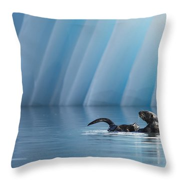 Otter Pop Throw Pillow by Ted Raynor