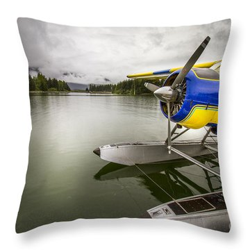 Idle Float Plane At Juneau Airport Throw Pillow by Darcy Michaelchuk