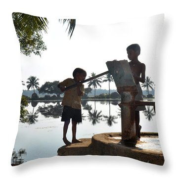 Indian Boys Pumping Water Throw Pillow by Diane Lent