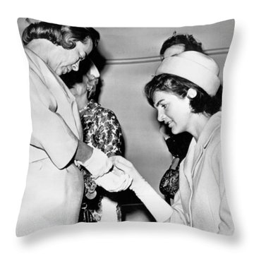 Jackie Inspects Gold Bracelet Throw Pillow by Underwood Archives