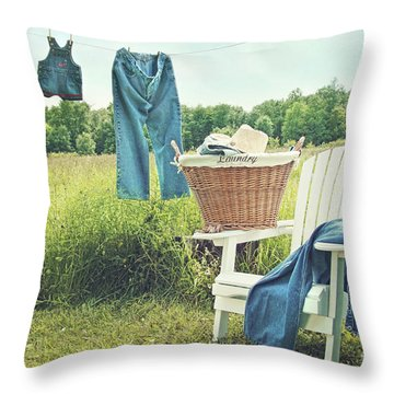 Jeans Hanging On Clothesline On A Summer Afternoon Throw Pillow by Sandra Cunningham