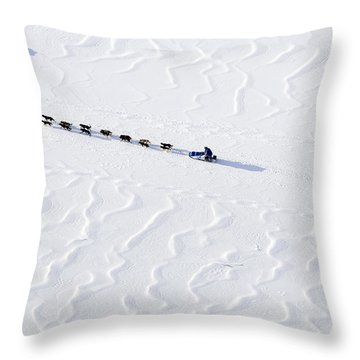John Bakers Team Running Down Frozen Yukon River  Throw Pillow by Jeff Schultz