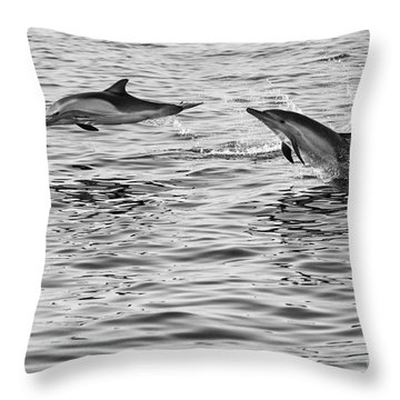Jump For Joy - Common Dolphins Leaping. Throw Pillow by Jamie Pham