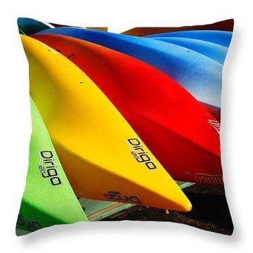 Kayaks Await Throw Pillow by James Kirkikis