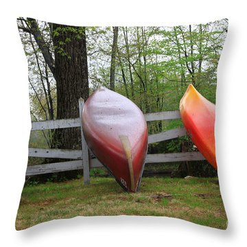 Kayaks On Fence 2 Throw Pillow by Michael Mooney