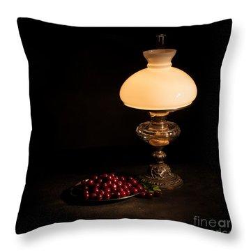 Kerosene Lamp Throw Pillow by Torbjorn Swenelius